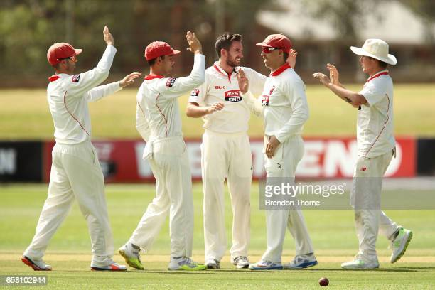 Chadd Sayers of the Redbacks celebrates with team mates after claiming the wicket of Cameron White of the Bushrangers during the Sheffield Shield...