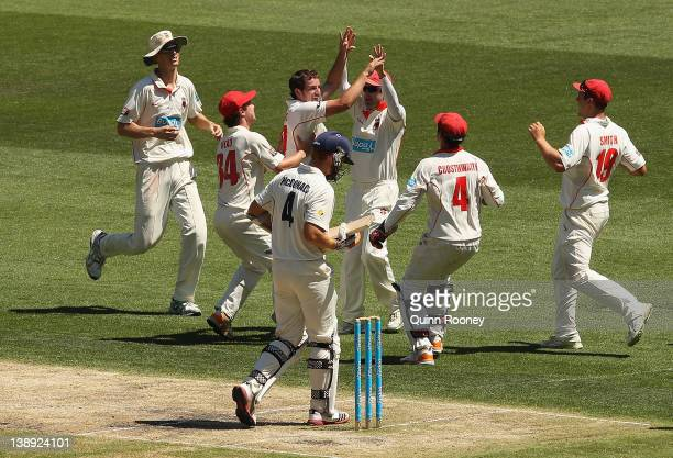 Chadd Sayers of the Redbacksis congratulated by teammates after getting the wicket of Andrew McDonald of the Bushrangers during the Shieffield Shield...