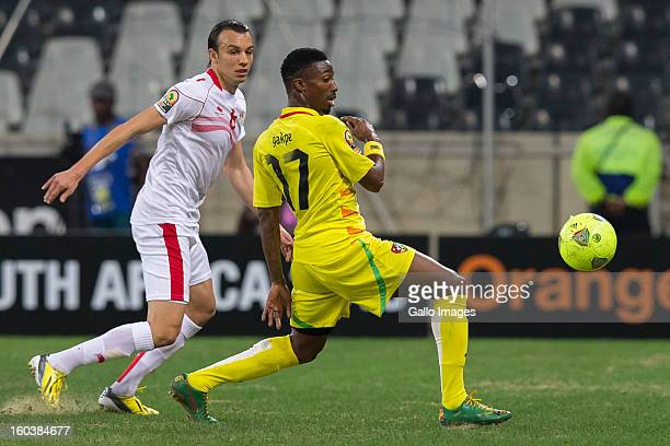 Chadi Hammami of Tunisia and Serge Gakpe of Togo during the 2013 Orange African Cup of Nations match between Togo and Tunisia at Mbombela Stadium on...