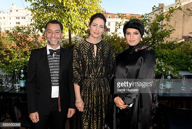 Chadi Zeneddine Hanaa Issa and Doha Film Institue CEO Fatma Al Remaihi attend a dinner to celebrate Asghar Farhadi's The Salesman which premiered at...