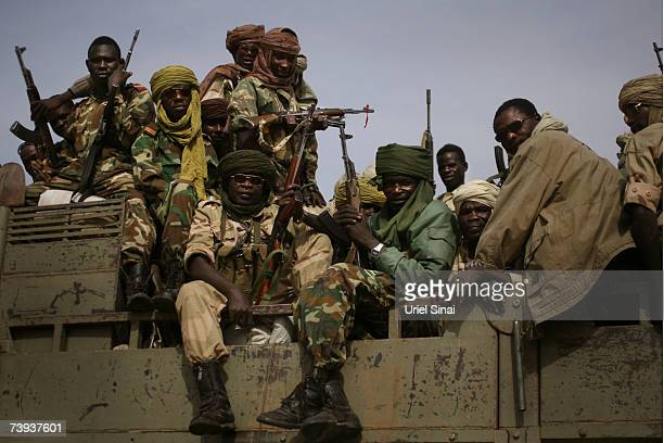 Chadian army soldiers prepare to move out in a transport vehicle April 20 2007 near Koukou Chad Reportedly 30 people have been killed following...
