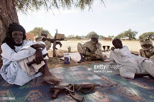 Chadian army soldiers rest during their assignment to protect village people and their children after an attack on their village forced them to flee...