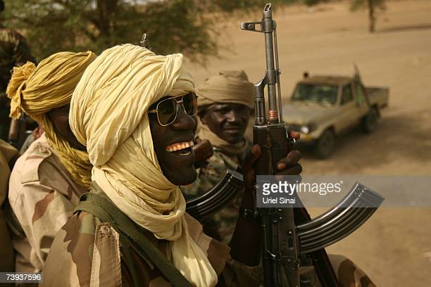 Chadian army soldiers sit on top fo a transport vehicle preparing to move out April 20 2007 near Koukou Chad Reportedly 30 people have been killed...