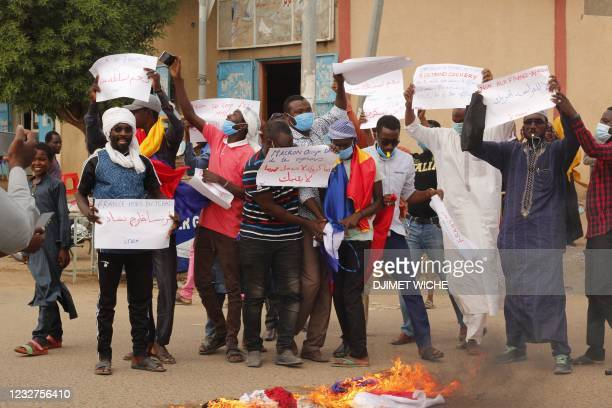 Chadian demonstrators carry banners with anti France slogans as they demonstrate in Ndjamena on May 8, 2021. - The Chadian police dispersed on...