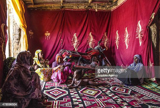 N'DJAMENA CHAD JUNE 22 A Chadian family in a village house near the capital N'djamena Chad on June 22 2015 Polygamy is very common in Chad men can...