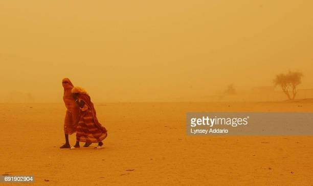 Chadian girls brave a sandstorm in Bahai Chad roughly seven kilometers from the Sudan border August 18 2004 Thousands of refugees have streamed out...