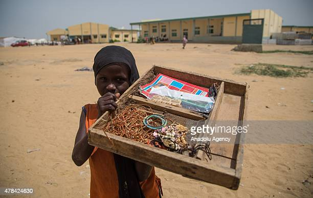 N'DJAMENA CHAD JUNE 22 A Chadian kid holds a stand as she sells ornaments at a slumdog of N'djamena Chad on June 22 2015 Referred to as the 'Dead...