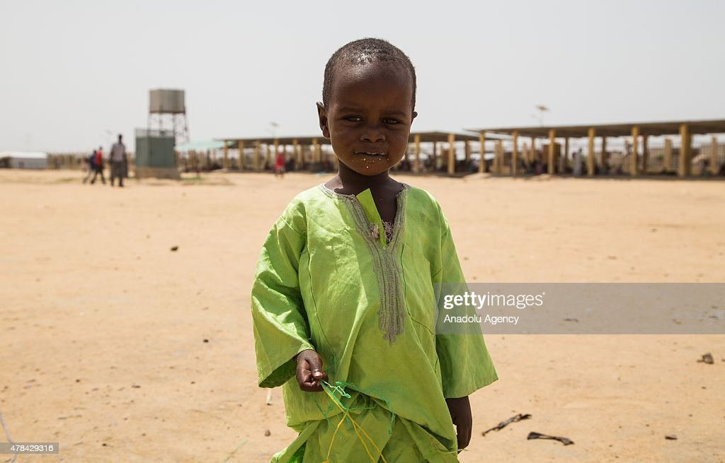 N'DJAMENA, CHAD - JUNE 22: A Chadian kid holds bottle taps at a slumdog of N'djamena, Chad on June 22, 2015. Referred to as the 'Dead Heart of Africa', the majority of Chads population does not respect the rights of children. One of the main problems faced by children is poverty. Chad, a crossing point between sub-Saharan Africa and North Africa, is one of the poorest countries in the world. Thus, poverty, which affects a vast majority of young Chadians, has serious repercussions on their access to a healthy diet, adequate financial resources, healthcare, etc. Also, in Chad, the mortality rate of children under five is very worrisome. In fact, due to the lack of sanitation, drinking water and healthcare in rural areas, 209 children out of 1000 die every year. Another problem is education. The population of Chad is so disparate that Childrens Rights to education are compromised. In addition, parents are often reluctant to send their children to school. Only a small percentage of children in Chad are schooled. Crucial problem is child marriages. The marriage of young girls is still a common practice in Chad, as the age of majority is set differently within various documents. From a legal point of view, civil majority is reached at 21 years and the legal age of marriage is set at 15 years for girls and 18 years for boys. However in customary law, the age of marriage is implicitly set at 13 years, which goes against the International Convention on the Rights of the Child. Other issue is child labor. In Chad, the minimum age for employment is 14 years. However, due to economic difficulties, many families are often forced to make their children work.