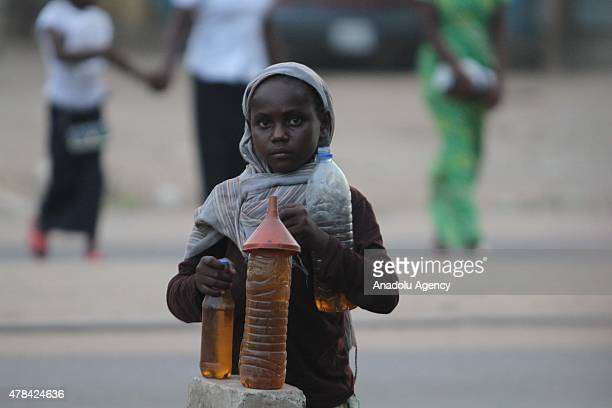 N'DJAMENA CHAD JUNE 22 A Chadian kid sells beverages at a slumdog of N'djamena Chad on June 22 2015 Referred to as the 'Dead Heart of Africa' the...