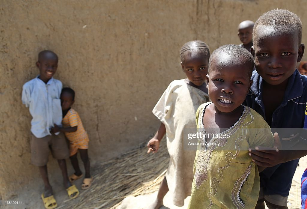 N'DJAMENA, CHAD - JUNE 22: Chadian kids seen among street alley at a slumdog of N'djamena, Chad on June 22, 2015. Referred to as the 'Dead Heart of Africa', the majority of Chads population does not respect the rights of children. One of the main problems faced by children is poverty. Chad, a crossing point between sub-Saharan Africa and North Africa, is one of the poorest countries in the world. Thus, poverty, which affects a vast majority of young Chadians, has serious repercussions on their access to a healthy diet, adequate financial resources, healthcare, etc. Also, in Chad, the mortality rate of children under five is very worrisome. In fact, due to the lack of sanitation, drinking water and healthcare in rural areas, 209 children out of 1000 die every year. Another problem is education. The population of Chad is so disparate that Childrens Rights to education are compromised. In addition, parents are often reluctant to send their children to school. Only a small percentage of children in Chad are schooled. Crucial problem is child marriages. The marriage of young girls is still a common practice in Chad, as the age of majority is set differently within various documents. From a legal point of view, civil majority is reached at 21 years and the legal age of marriage is set at 15 years for girls and 18 years for boys. However in customary law, the age of marriage is implicitly set at 13 years, which goes against the International Convention on the Rights of the Child. Other issue is child labor. In Chad, the minimum age for employment is 14 years. However, due to economic difficulties, many families are often forced to make their children work.