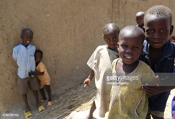 N'DJAMENA CHAD JUNE 22 Chadian kids seen among street alley at a slumdog of N'djamena Chad on June 22 2015 Referred to as the 'Dead Heart of Africa'...