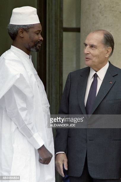 Chadian President Hissene Habre is welcomed by French President Francois Mitterrand , on July 13, 1987 at the Elysee Palace, in Paris.
