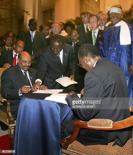 Chadian President Idriss Deby Itno and his Sudanese counterpart Omar alBeshir sign a peace accord in the presence of Senegalese Foreign Minister...