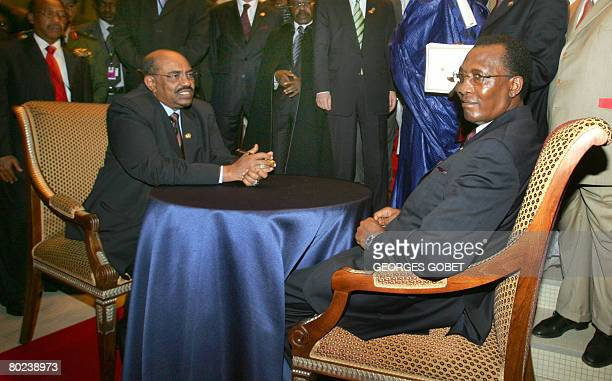 Chadian President Idriss Deby Itno and his Sudanese counterpart Omar alBeshir attend a peacesigning meeting in the presence of Senegalese Foreign...