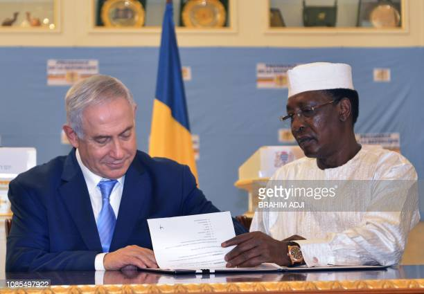 Chadian President Idriss Deby Itno and Israeli Prime Minister Benjamin Netanyahu sign documents after their meeting at the presidential palace in...