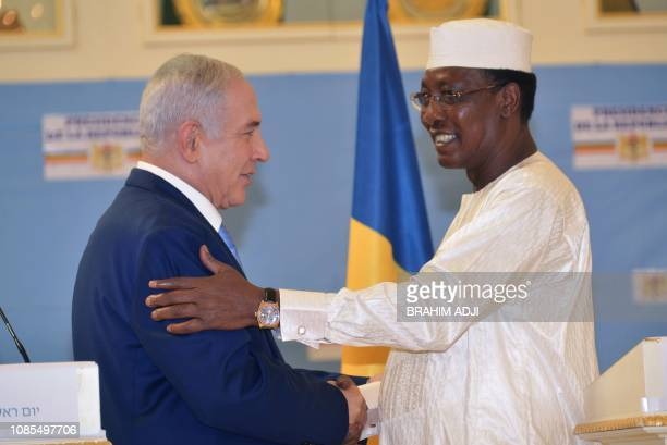 Chadian President Idriss Deby Itno shakes hands with Israeli Prime Minister Benjamin Netanyahu during a meeting at the presidential palace in...