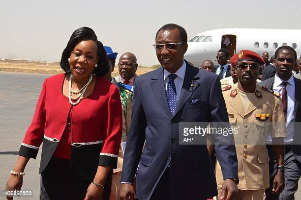 Chadian President Idriss Deby Itno welcomes Central African interim President Catherine Samba Panza shortly after her arrival at N'Djamena airport on...