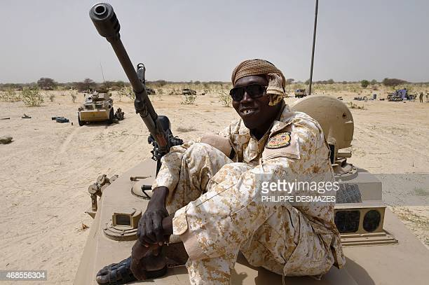 A Chadian soldier sits on top of an armoured vehicle near Malam Fatori on April 3 after the town in northeastern Nigeria was retaken from Boko Haram...