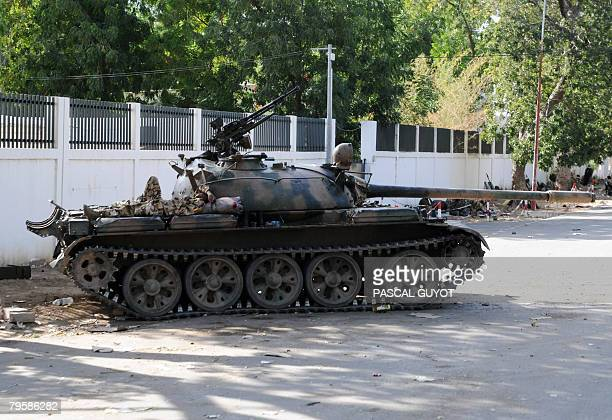A Chadian soldier sleeps on his Chadian army T55 tank in position on February 6 2008 in Ndjamena French Defence Minister Herve Morin on an...