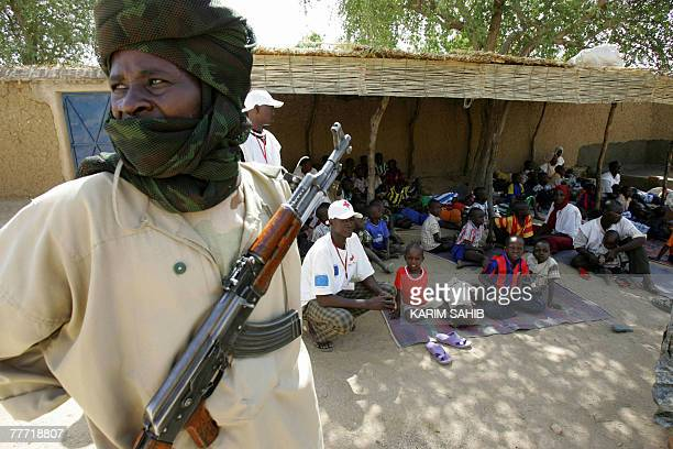 A Chadian soldier stands in front of children at an orphanage serving as the temporary home of 103 chidren at the centre of an 'abduction' row in...