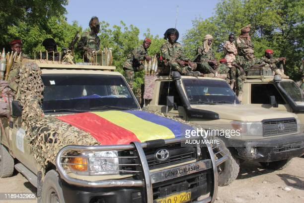 Chadian soldiers belonging to the Joint Task Force gesture while patrolling in Monguno on December 15 2019 Fourteen people were killed and 13 were...