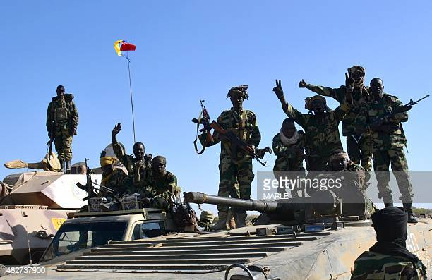 Chadian soldiers gather on February 1 2015 near the Nigerian town of Gamboru just accros the border from Cameroon In a deserted Gamboru Chadian...