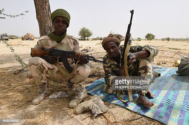Chadian soldiers pose with their arms near Malam Fatori on April 3 after the town in northeastern Nigeria was retaken from Boko Haram by troops from...