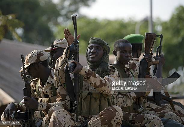 Chadian soldiers prepare to leave an Africanled International Support Mission to the Central African Republic military camp in Bangui on April 4 2014...