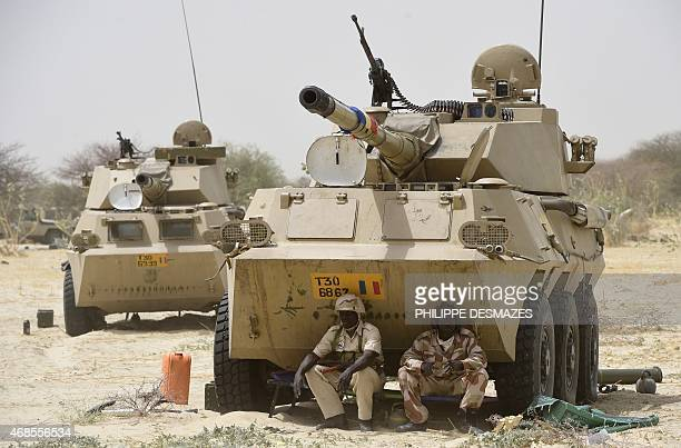 Chadian soldiers rest in the shade of their armoured vehicle near Malam Fatori on April 3 after the town in northeastern Nigeria was retaken from...