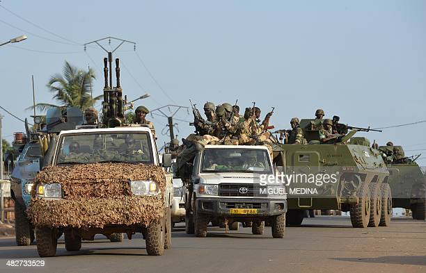 Chadian soldiers sit on a pickup truck as they leave Bangui on April 4 escorted by Africanled International Support Mission to the Central African...