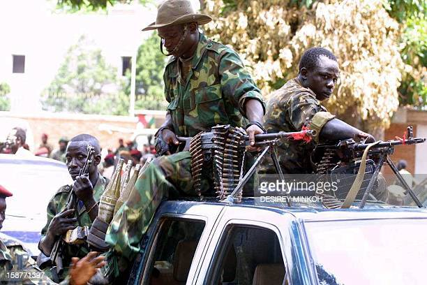 Chadian soldiers stand guard during the visit of General Francois Bozize Central Africa's selfproclaimed new leader at the De Roux camp in Bangui...