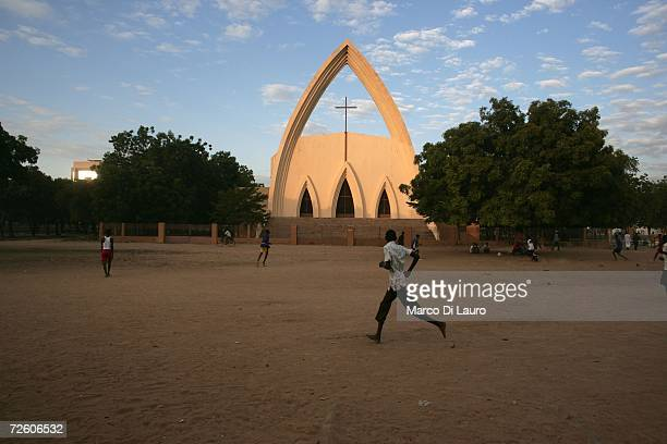 N'DJAMENA CHAD NOVEMBER 3 Chadian teenagers play football in front of the main Catholic Cathedral on November 3 2006 in N'Djamena Chad Chad declared...