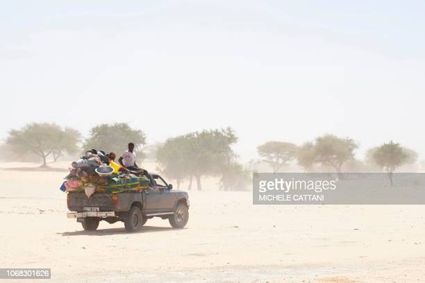 Chadian travels on a overloaded truck across the desert on the way to Bol in southern Chad on November 9 2018 These old and overcharged allterrain...