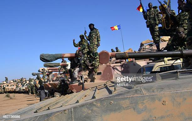 Chadian troops gather on February 1 2015 near the Nigerian town of Gamboru just accros the border from Cameroon In a deserted Gamboru Chadian forces...
