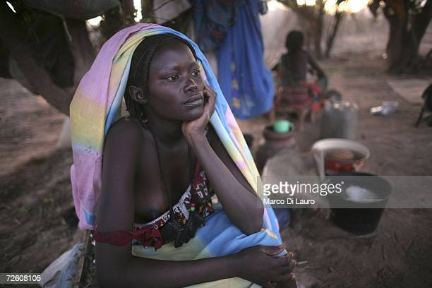 Chadian village woman looks on as she takes shelter under trees after an attack on her village forced her to flee to a site for internally displaced...