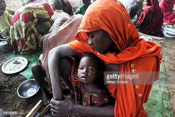 Chadian village woman protects her child as they take shelter under trees after an attack on their village forced them to flee on November 12 2006 in...