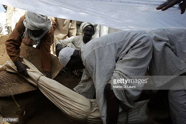 Chadian Villagers hold a funeral for a 80yearsold woman who died of natural causes as they find shelter under trees after an attack on their village...