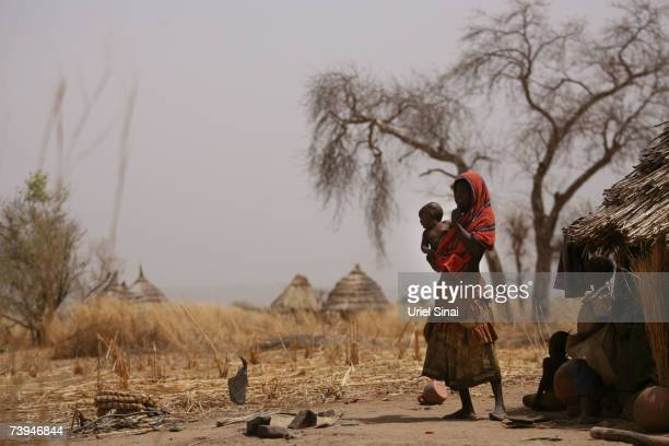 A Chadian woman and her children seen in the abandoned Aramgo village that was attacked by Janjawid southwest of Goz Beida April 22 2007 in Chad...