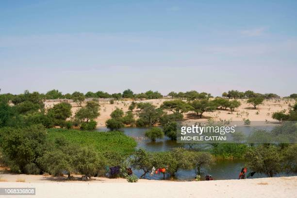 Chadian women wash their clothes on the side of Lake Chad on November 7 2018