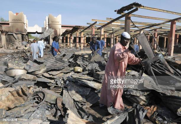 Chadians clean the rubble off the central market destroyed during clashes between insurgents and Chadian army on February 11 2008 in N'Djamena...