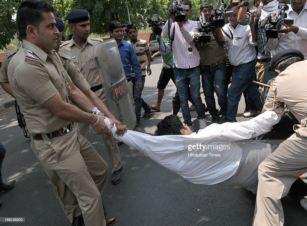 Chadigarh police personnel forcefully removing BJP protesters during the dharna against the Union Railway Minister Pawan Kumar Bansal outside the CBI.