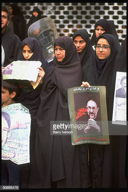 Chador-clad women supporters of moderate cleric Mohammed Khatami holding posters picturing presidential candidate during election campaign street...