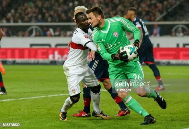 Chadrac Akolo of Stuttgart and Goalkeeper Sven Ulreich of Muenchen battle for the ball during the Bundesliga match between VfB Stuttgart and FC...