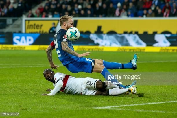 Chadrac Akolo of Stuttgart and Kevin Vogt of Hoffenheim battle for the ball during the Bundesliga match between TSG 1899 Hoffenheim and VfB Stuttgart...
