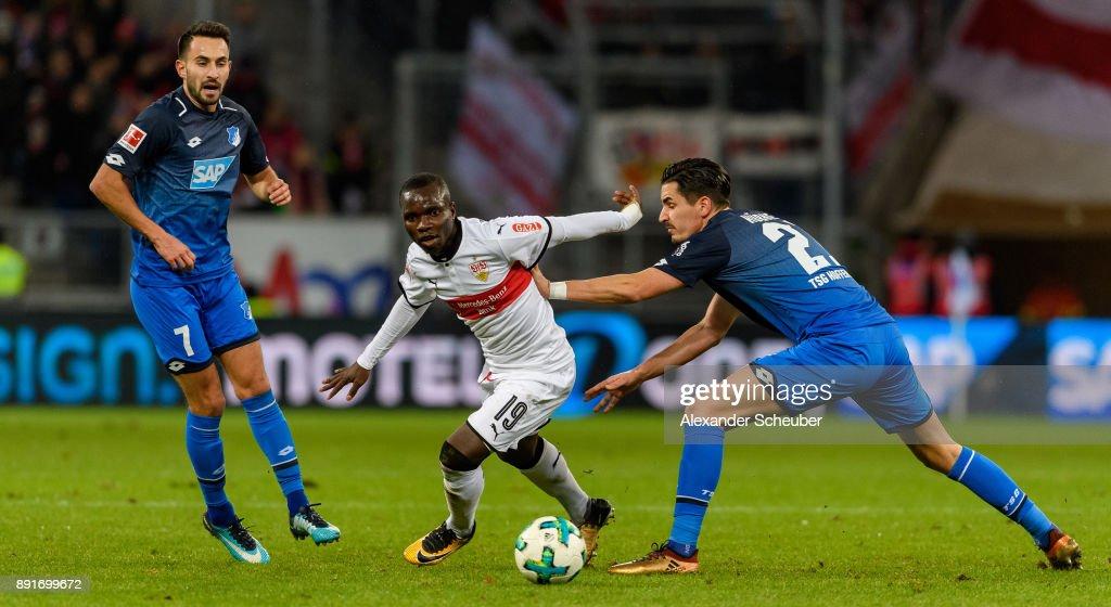 Chadrac Akolo of Stuttgart in action against Benjamin Huebner of Hoffenheim during the Bundesliga match between TSG 1899 Hoffenheim and VfB Stuttgart at Wirsol Rhein-Neckar-Arena on December 13, 2017 in Sinsheim, Germany.