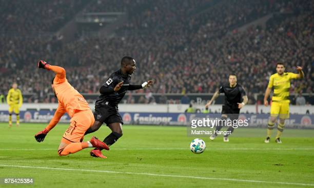 Chadrac Akolo of Stuttgart is on his way past goalkeeper Roman Buerki of Dortmund to score his teams first goal during the Bundesliga match between...