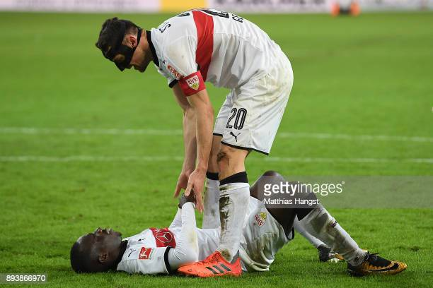 Chadrac Akolo of Stuttgart lies on the pitch after he missed a penalty as Christian Gentnerof Stuttgart talks to him during the Bundesliga match...