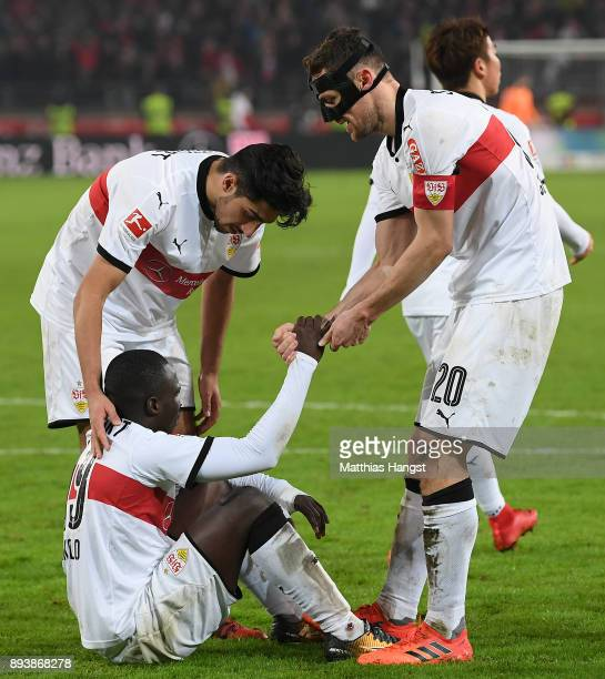 Chadrac Akolo of Stuttgart lies on the pitch after he missed a penalty as Christian Gentnerof Stuttgart shakes his hand during the Bundesliga match...