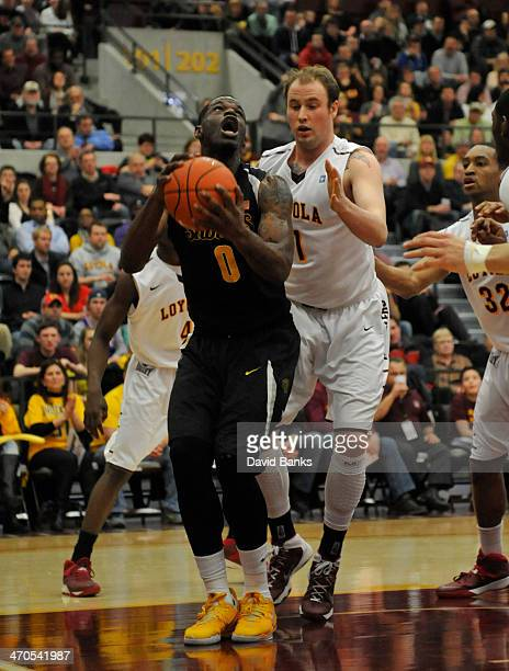 Chadrack Lufile of the Wichita State Shockers is defended by Cody Johnson of the LoyolaChicago Ramblers on February 19 2014 at the Joseph J Gentile...