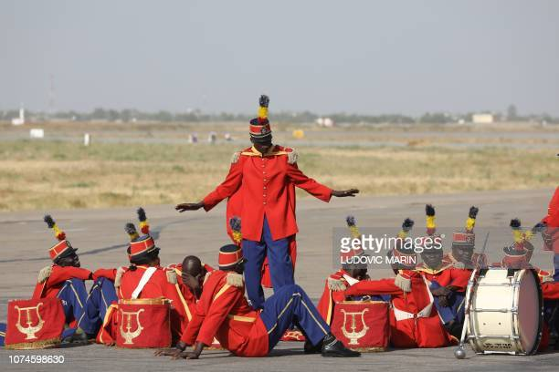 Chad's fanfare soldiers wait for French president's arrival at the international airport of N'Djamena on December 22 2018 French president is on...